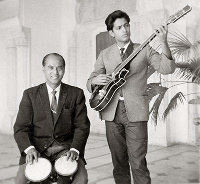 "Amancio with  Connie D'Souza, drummer and friend, playing the lunchtime session at the Rambagh Palace hotel in Jaipur, owned by the Maharani. 1965. Amancio worked the ""winter"" high season at this hotel in 1964. In 1965 Amancio got married in Jaipur where Connie gave away the bride to be, Joyce."