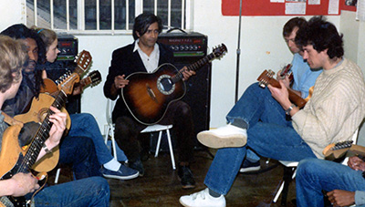 Amancio teaching a guitar class at Jenako Arts Centre London around 1990. Bruce Pollin, a good friend of Amancio's on the right